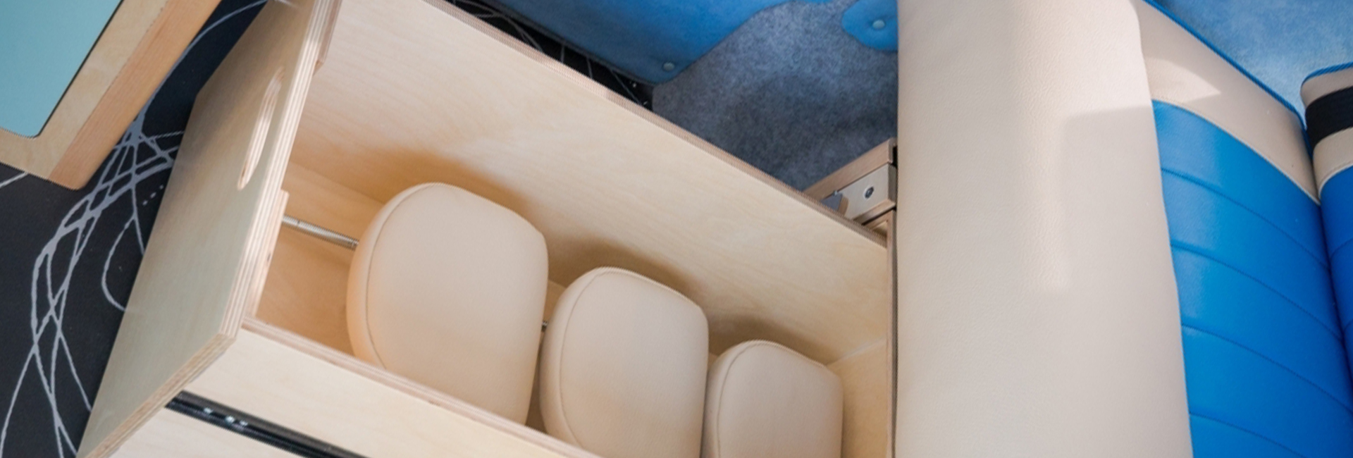 rock and roll bed storage draw with headrests for campervan