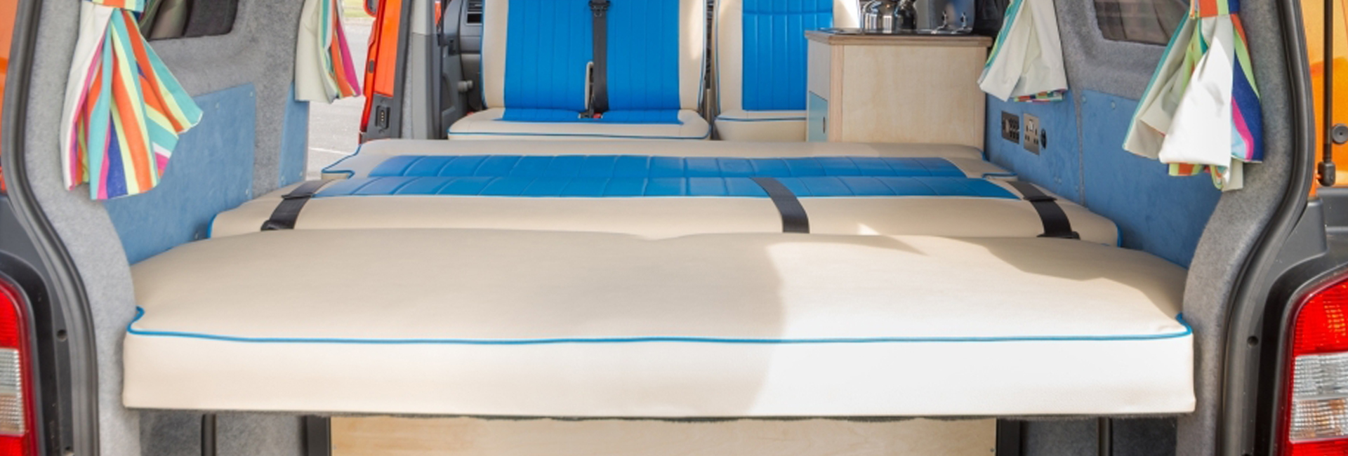 rock and roll white and blue bed campervan down flat