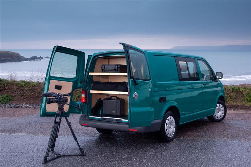 VW campervan parked at the beach with portable camera crew studio with bespoke fitting for equipment