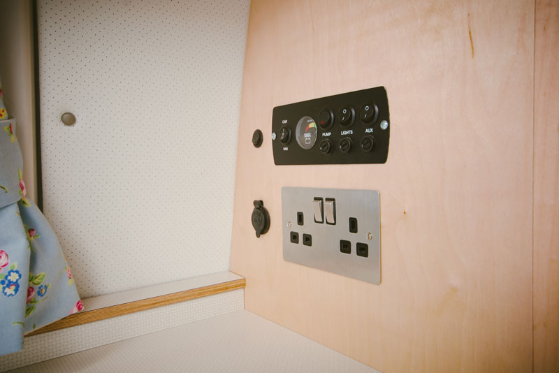 plug socket and ambient controls in campervan buil in to plywood