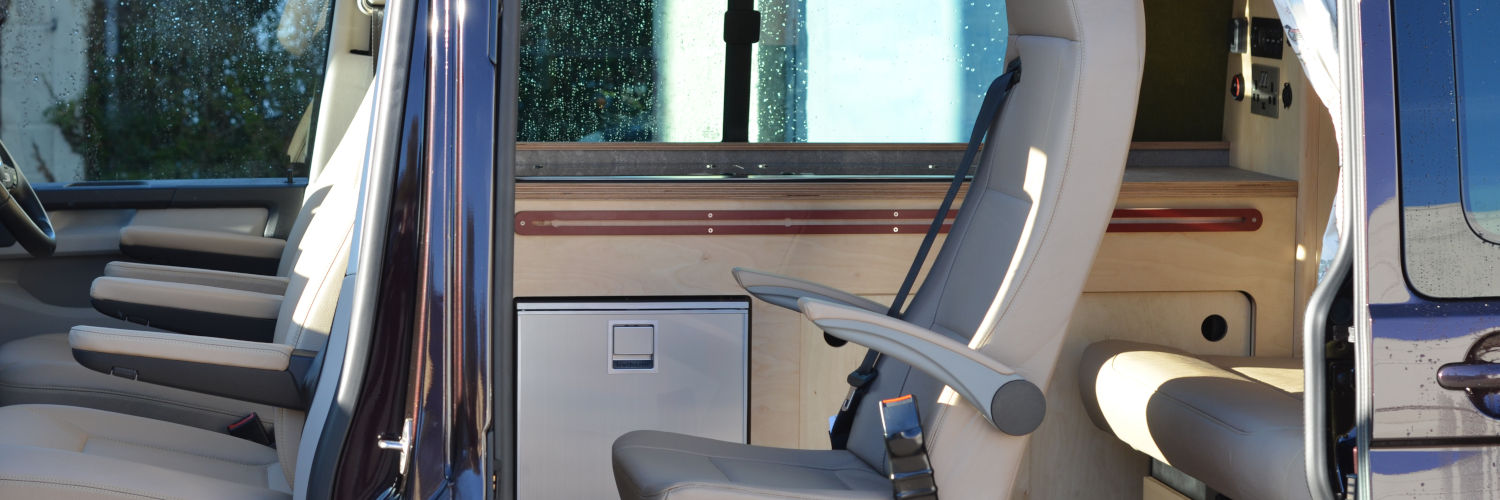 Stylish camper van with doors open showing additional buddy seating