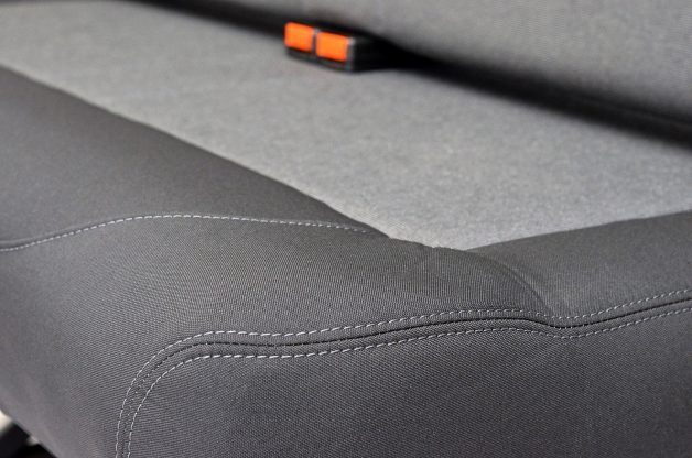 Close up of white stitching on upholstery seat in campervan