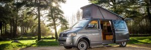 T5 VW Campervan parked in beautiful woodland with doors and elevating roof up