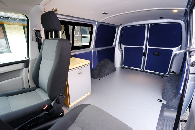 Partial campervan with blue lining panels and fridge