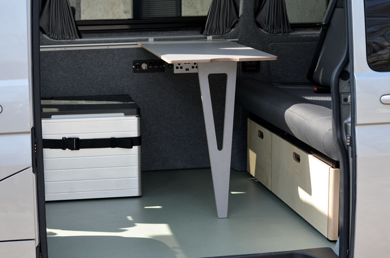 Grey campervan bespoke foldout table with removable cool box and under seat storage