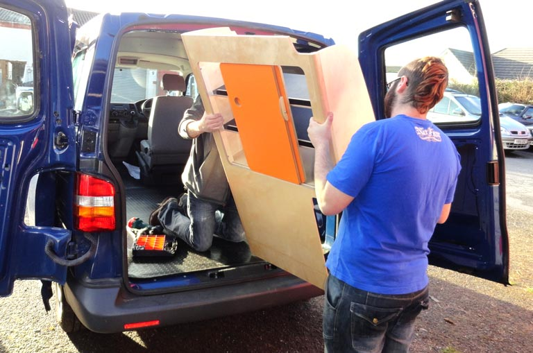 Cambee staff fitting our custom made campervan storage units