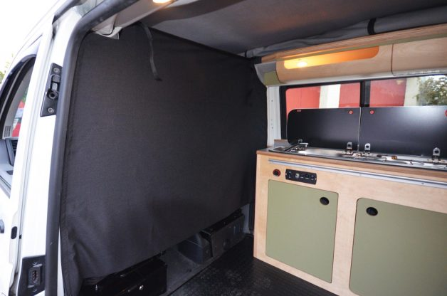 kitchen sink and cabinet interior with stealth curtain with velcro for van conversion