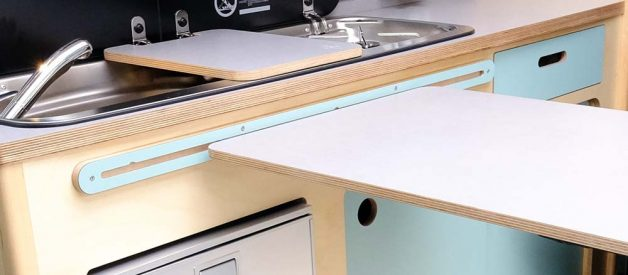 Close up of Cambee adjustable table and cabinets for van conversion