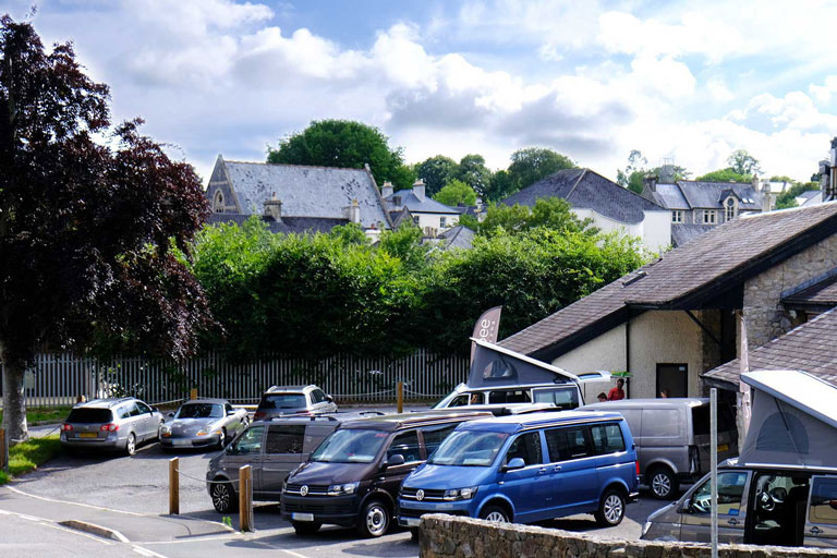 Side view of campervans parked at Cambee