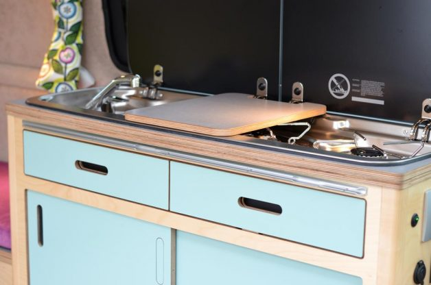 Close up of appliances in Maxi Pod removable kitchen with chopping board