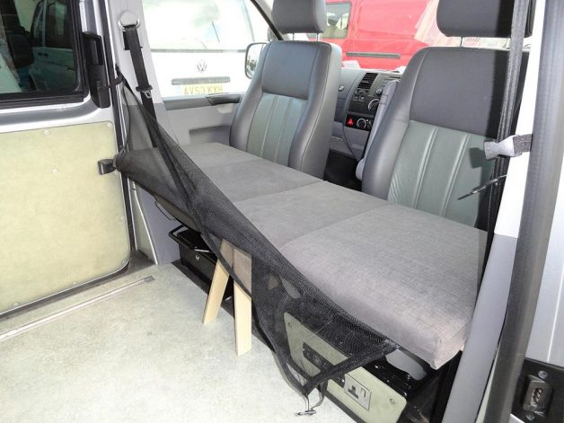 Campervan cab bunk for kids with safety net down