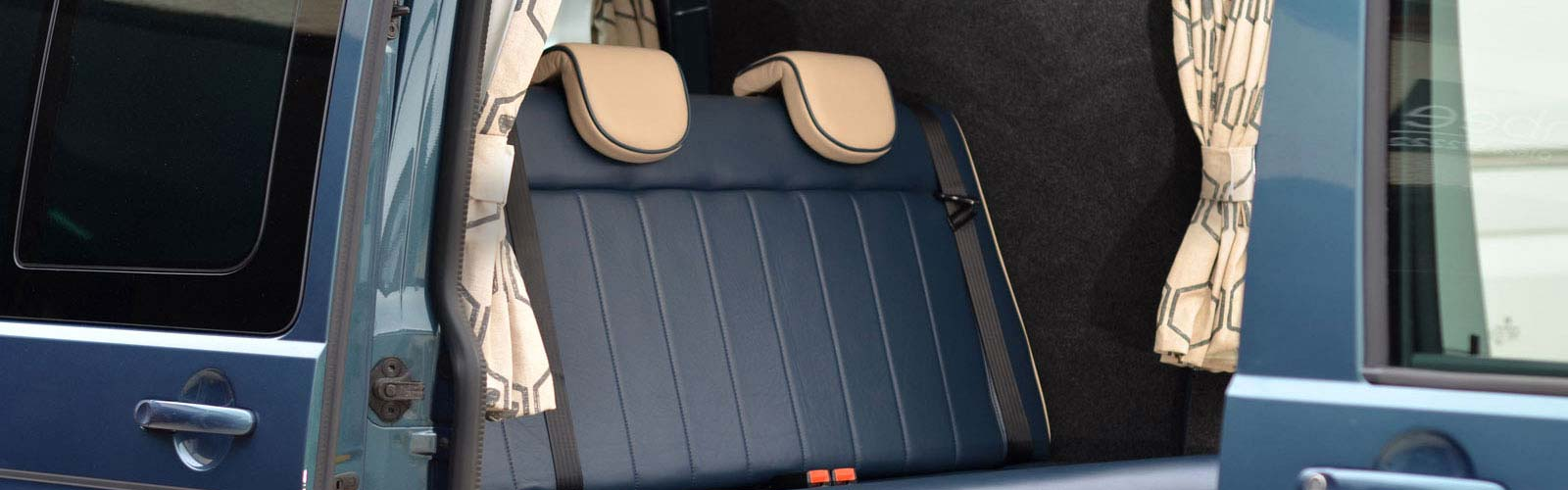 Interior of VW Transporter camper showing leather seats