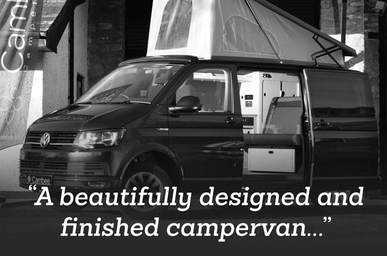 Black and white review image of campervan with roof up