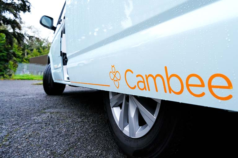 Low angle of VW Transporter sliding door with Cambee logo