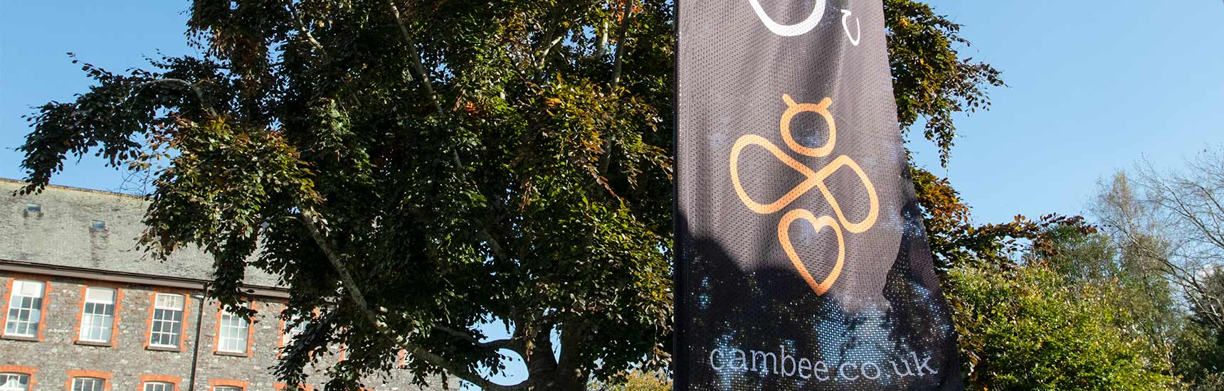 Cambee flag outside with branding