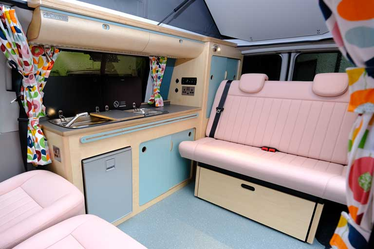 Interior baby pink and blue Cambee Classic conversion with swivel seats