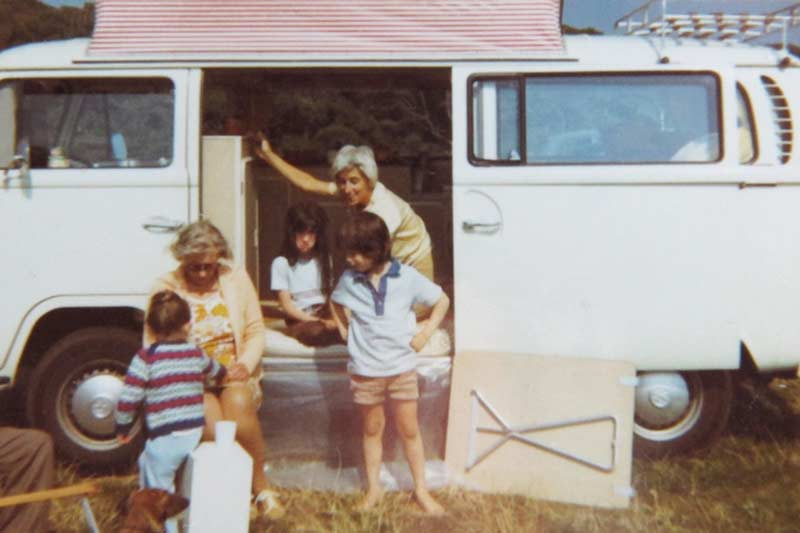 Retro van conversion showing a family with the sliding door open