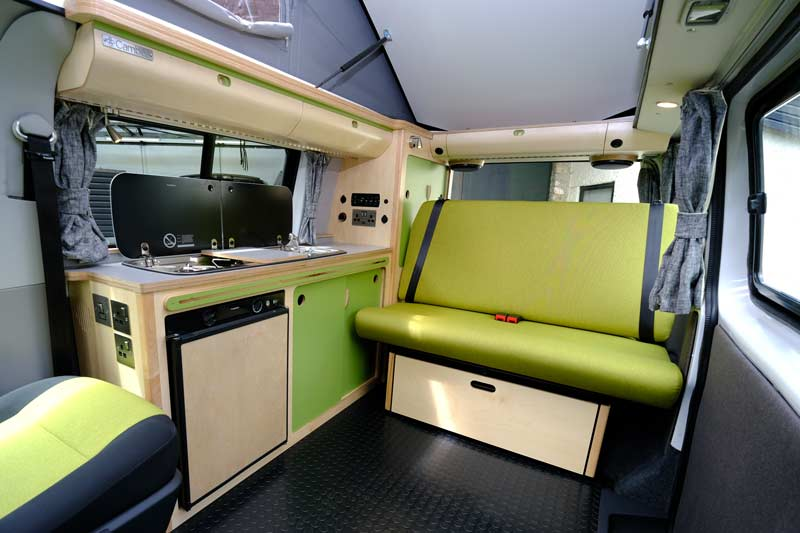 Green rock and roll bed inside campervan